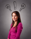 Young lady thinking with question marks overhead Stock Photos