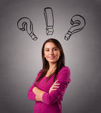 Young lady thinking with question marks overhead Royalty Free Stock Photos