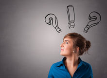 Young lady thinking with question marks overhead Stock Images