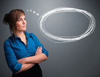 Young lady thinking about speech or thought bubble with copy spa Stock Images