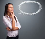 Young lady thinking about speech or thought bubble with copy spa Royalty Free Stock Images
