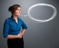 Young lady thinking about speech or thought bubble with copy spa Royalty Free Stock Photos