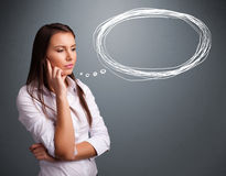Young lady thinking about speech or thought bubble with copy spa Stock Photos