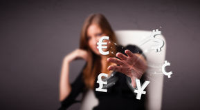 Young lady throwing currency icons Stock Photos
