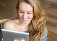 Young lady with touchscreen tablet Stock Image