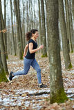 Young lady trail running Royalty Free Stock Photography