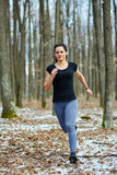 Young lady trail running Royalty Free Stock Photo