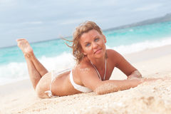 Young lady on tropical beach royalty free stock image