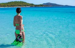 Young lady into tropical blue sea with snorkeling Royalty Free Stock Photo