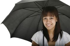 Young Lady with Umbrella. A smiling young lady holding an umbrella Royalty Free Stock Images
