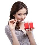Young lady unwraps her gift Royalty Free Stock Photos