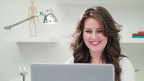 A Young Lady Using a Computer Indoors stock photos