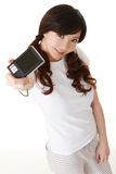 Young lady using digital camera Stock Photography