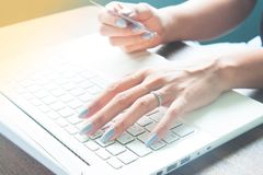 Young lady using laptop and credit card. For online shopping Stock Photography