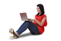 Young lady using laptop on the floor Stock Photography