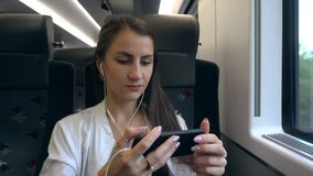 A Young Lady Using a Smartphone in the Train. Medium shot stock video