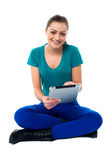 Young lady using tablet pc Stock Image