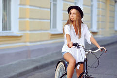 Young lady on a vintage bicycle looking at copyspace Royalty Free Stock Image