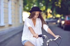 Young lady on a vintage bike outdoor portrait Stock Photos