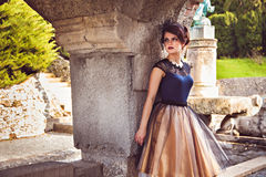 Young lady in vintage dress near the column of the castle Roseburg Stock Photo