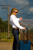 Young lady waiting for a train Royalty Free Stock Image