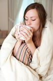 Young lady waking up Stock Photography