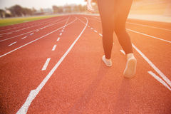 Young lady walking on athletics stadrium Stock Photography