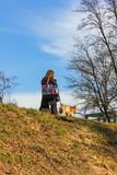 Young lady walking with dog. In city park at south germany spring stock photos