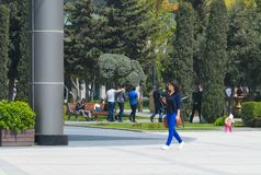 Young lady walks with phone Stock Photo