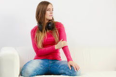 Young lady wearing headphones. Stock Image