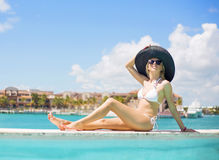 Young lady in white bikini relaxing in luxury resort Royalty Free Stock Image