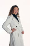 Young lady in white jacket. Posed on white background Stock Image