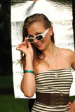 Young lady in white sunglasses Royalty Free Stock Image