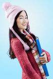 Young lady in winter clothes wink Stock Image