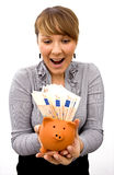 Young Lady With Piggy Bank Stock Photo