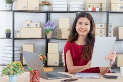Young lady working at home office stock images
