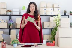 Young lady working at home office royalty free stock photography