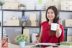 Young lady working at home office stock photography