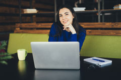 Young lady working at laptop in modern office hub Stock Photography