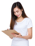 Young lady write on clipboard Royalty Free Stock Images