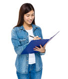 Young lady write on the paper board Royalty Free Stock Images