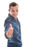 Young laid back man giving thumbs up to camera in. Blue denim shirt isolated on white background - the winner Royalty Free Stock Photos