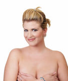 Young large blond woman covering bare breasts. Portrait of young blond woman bare shoulders hands on breasts Royalty Free Stock Photos