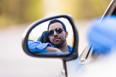Young latin american driver  driving his new car Royalty Free Stock Images