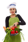 Young latin cook lady with vegetables in frying pan Stock Image