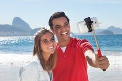 Young latin couple at beach Stock Image