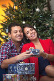 Young latin couple celebrating Christmas Royalty Free Stock Images