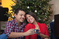 Young latin couple celebrating Christmas Stock Images