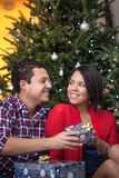 Young latin couple celebrating Christmas Royalty Free Stock Image