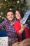 Young latin couple celebrating Christmas Stock Photos